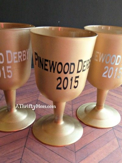 quick, inexpensive trophy idea, great for a pinewood derby, #trophy, #spraypaint, #plasticcup, #vinyl, #easycraft, #thriftycraft,#thriftytrophy, #scouting